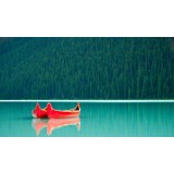 Canoes on still water, Lake Louise Banff Canada
